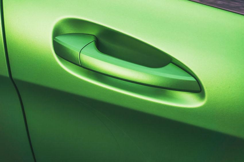 Close-up of green car door handle Berlin Germany 🇩🇪 Deutschland Horizontal Car Car Door Car Door Handle Close-up Color Image Day Green Color Land Vehicle Mode Of Transport Modern No People Outdoors Transportation