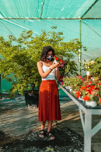 Woman looking at flowering plants