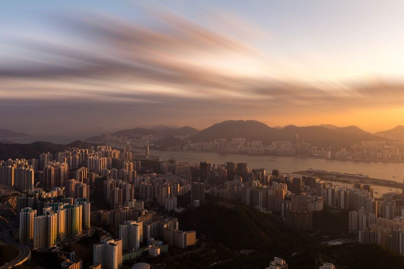 Hongkong city in sunset time Getty Images Getty Hongkongphotography Hongkong Photos City Hongkong City Hk HongKong Sunset Scenics Beauty In Nature No People Outdoors Modern City Nature Built Structure Water Day