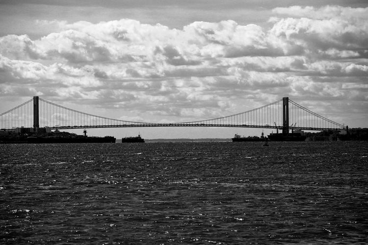 Architecture B&w Street Photography Black And White Bridge Bridge - Man Made Structure Built Structure City Cloud - Sky Connection Day Engineering New York City No People Outdoors River Sky Suspension Bridge Transportation Travel Travel Destinations Water Monochrome Photography My Year My View Let's Go. Together.