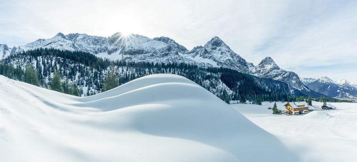 Winter scenery with austrian alps snow-covered. snowdrifts in ski resort in ehrwald, tyrol, austria.
