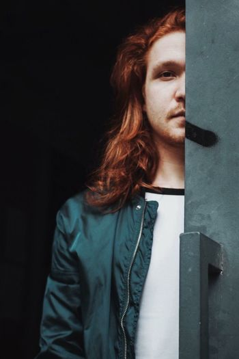 One Person Young Adult Redhead Portrait Looking Away Looking Hairstyle Casual Clothing Long Hair Hair Cool Guy Man Front View Indoors  Contemplation Standing Adult Black Background