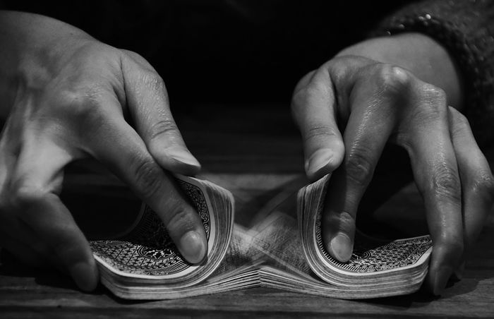 Shuffling. Black & White Hands Playing Cards Black And White Blackandwhite Bw Card Game Cards Close-up Day Human Body Part Human Finger Human Hand Indoors  One Person Preparation  Real People Shuffle Shuffling Fresh On Market 2017