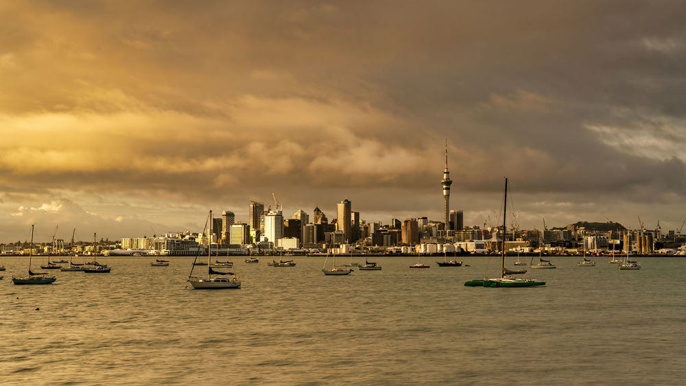 Golden hour sunrise in Auckland, New Zealand Sky Cloud - Sky Built Structure Architecture Building Exterior Water Nautical Vessel Waterfront City Sunset Sea Transportation Nature Building Tower No People Mode Of Transportation Tall - High Travel Destinations Cityscape Outdoors Skyscraper Office Building Exterior Sailboat Spire