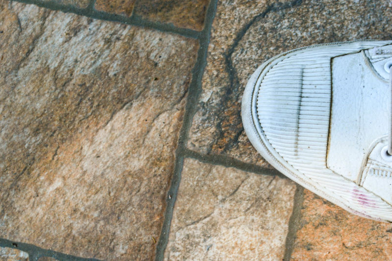 Shoes on stone floor Shoes On Stone Floor Shoe White Shoes Stone Floor Stone Texture Old Shoes Old High Angle View Outdoors Day No People Shoes On The Floor Men Shoes Close-up Solid Stand On The Floor Stone Pattern Stone Background Walking