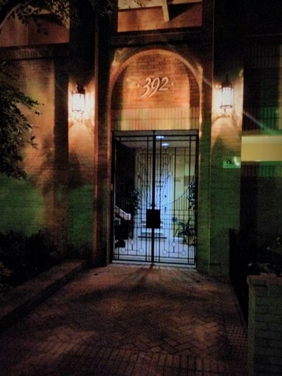 Entryway at 392 Glassell. It reminds me somewhat of a set on the old Gothic Soap Opera Dark Shadows from the 60's, primarily because if the lighting and confined nature of the image. Gateway Nightwalk Night Photography Wrought Iron Dramatic Light Nightlighting