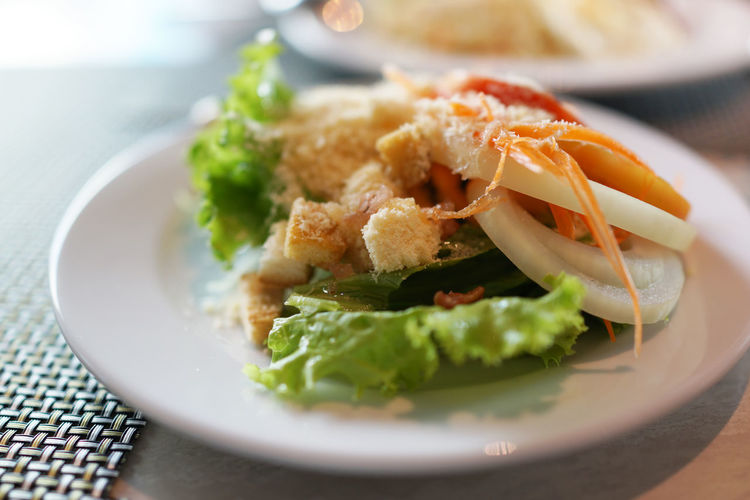 Caesar Salad Onion Rings Cheese Close-up Crockery Focus On Foreground Food Freshness Garnish Healthy Eating Indoors  Indulgence No People Place Mat Plate Ready-to-eat Salad Selective Focus Serving Size Snack Still Life Table Temptation Vegetable Vegetarian Food Wellbeing