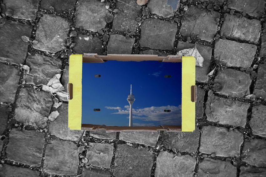 Tower Carton Pebbles Pattern Pavement No People Blue Day Architecture Yellow Built Structure Outdoors Directly Above Street