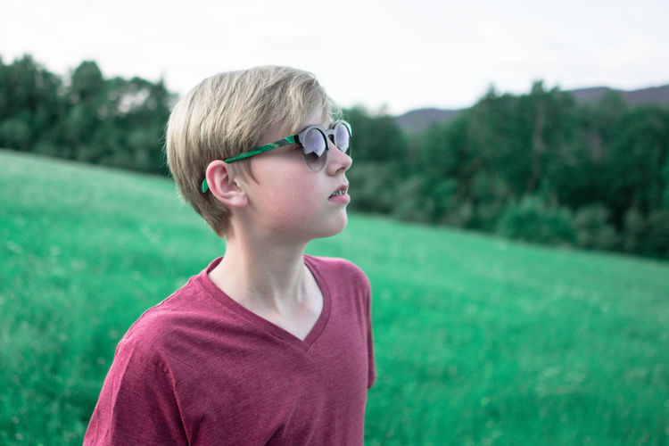 boy with sunglasses Alone Blond Boy Casual Clothing Child Childhood Cool Elementary Age Grass Headshot Leisure Activity Lifestyles Nature Outdoors Portrait Sunglasses Swag Teenager