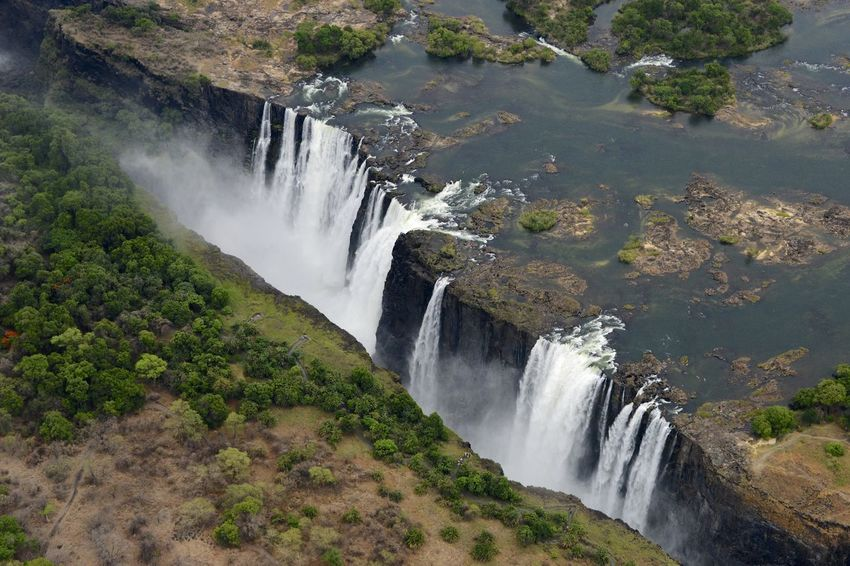 Arial Shot National Park Victoria Falls Africa Zimbabwe Zambesi River Zambia Zimbabwe Arial Arial Photography Arial View Arialview Border Power In Nature River Victoria Falls Victoria Falls In Zambia, Africa View From Helicopter Water Waterfall Zambesi