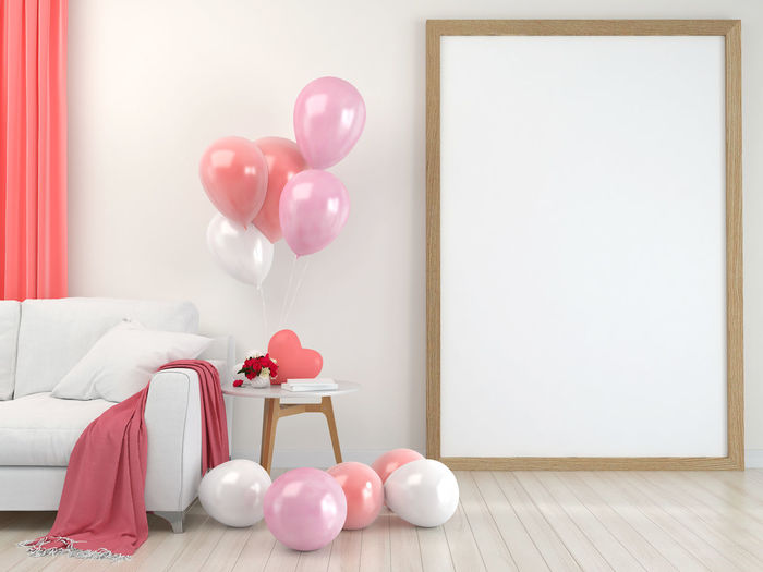 Multi colored balloons on table against wall at home