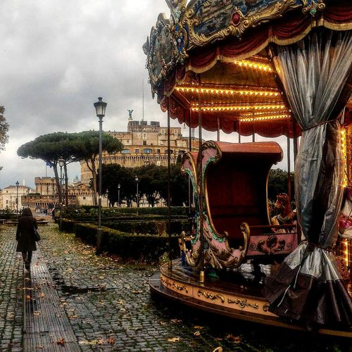 #kids #palace #photography Rome #rain  #rainyday #wet #castelsantangelo Carousel Tree Amusement Park Ride Amusement Park Sky Merry-go-round Christmas Market Christmas Decoration Fairy Lights
