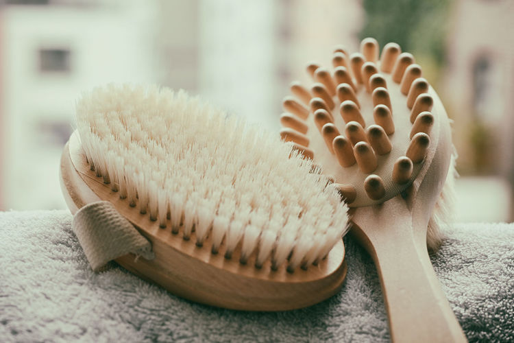 Close-up of brushes on towel against window