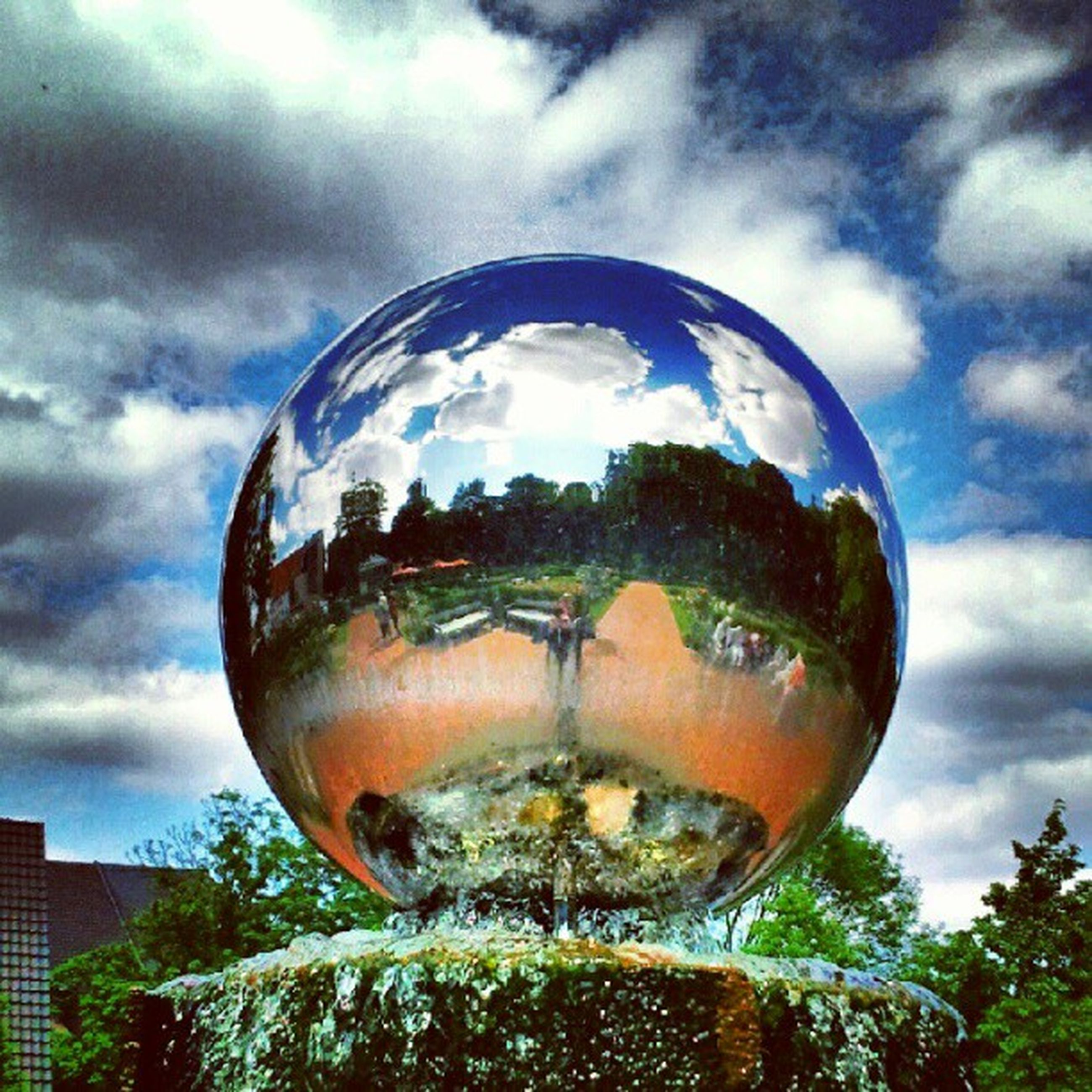 sky, cloud - sky, low angle view, cloudy, glass - material, sphere, transparent, tree, cloud, reflection, circle, weather, close-up, outdoors, no people, built structure, architecture, day, nature, shape