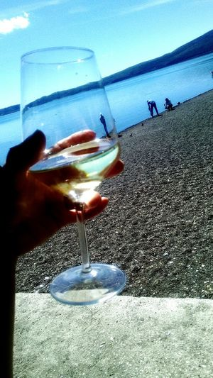 Wine Not Human Hand Food And Drink Water Drink Refreshment Beach Drinking Glass Sea Human Body Part Sand One Person Day Close-up Food Freshness Sky Shadow Outdoors People Healthy Eating Lago Trevignanoromano Travel Destinations
