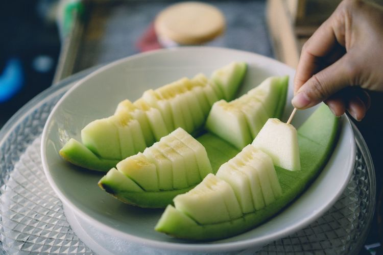 Food And Drink Food Sweet Food Indoors  Freshness Close-up Dessert Dumpling  Lifestyles Ready-to-eat Dim Sum Human Body Part One Person People Human Hand DayMelons Melone ผลไม้ ผลไม้อร่อย Nature
