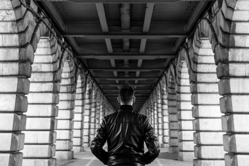 Rear View Of Man Under A Bridge