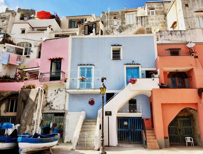 Balcony Balconies Colourful Houses Architecture Built Structure Day Outdoors Residential Building No People Fishing Harbor Buildings Architecture Colorful Prodica Island Italian Riviera Fishing Village Italy Pitoresque Light Blue