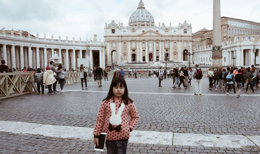 Girl standing with digital tablet against st peters basilica