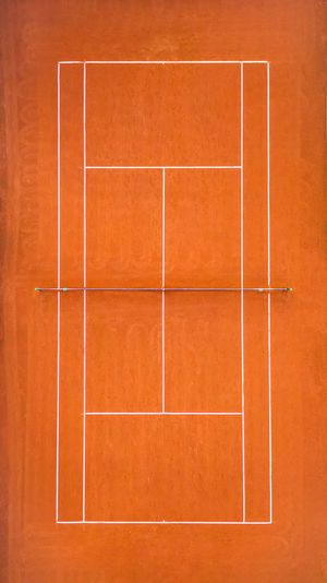 High angle view of tiled floor against orange wall