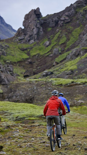 Man riding bicycle on mountain