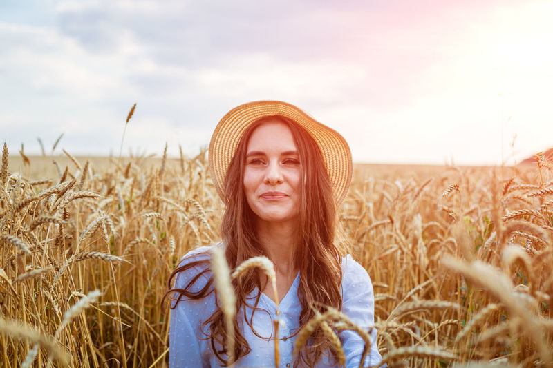Portrait of young woman standing in farm