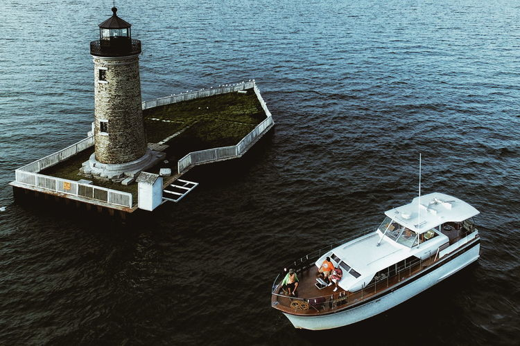 Boat Calm Day High Angle View Journey Light House Mode Of Transport Nature Nautical Vessel No People Non-urban Scene Ocean Outdoors Passenger Craft Scenics Sea Tranquil Scene Tranquility Transportation Water Waterfront A Bird's Eye View