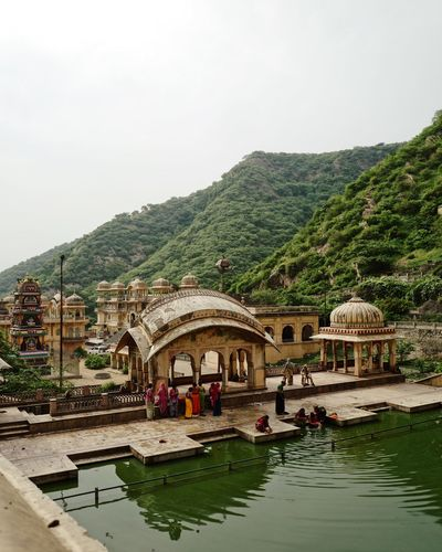 Bathing India Place Of Worship Architecture Beauty In Nature Building Exterior Built Structure Day Incidental People Incredible India Lake Lifestyles Mountain Nature Plant Rajasthan Reflection Sky Temple Tourism Travel Water Waterfront Well  Wellbeing
