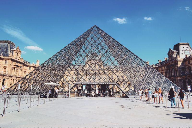 Lourve LourveMuseum Paris, France  Pyramid Triangle Shape Architecture People The Week On EyeEm EyeEm Selects Vacations Tourism Travel Breathing Space