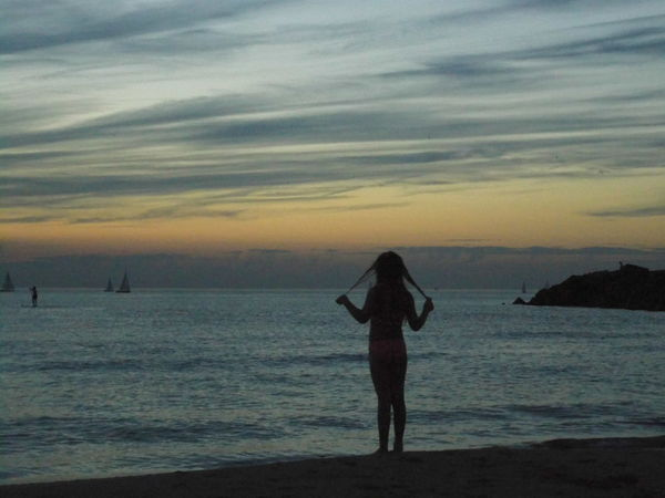Beach Beauty In Nature Cloud - Sky Dusk Full Length Getting Away From It All Idyllic Leisure Activity Mountain Nature Person Remote Scenics Sea Shore Silhouette Sky Standing Sunset Tourism Tourist Tranquil Scene Tranquility Vacations Water