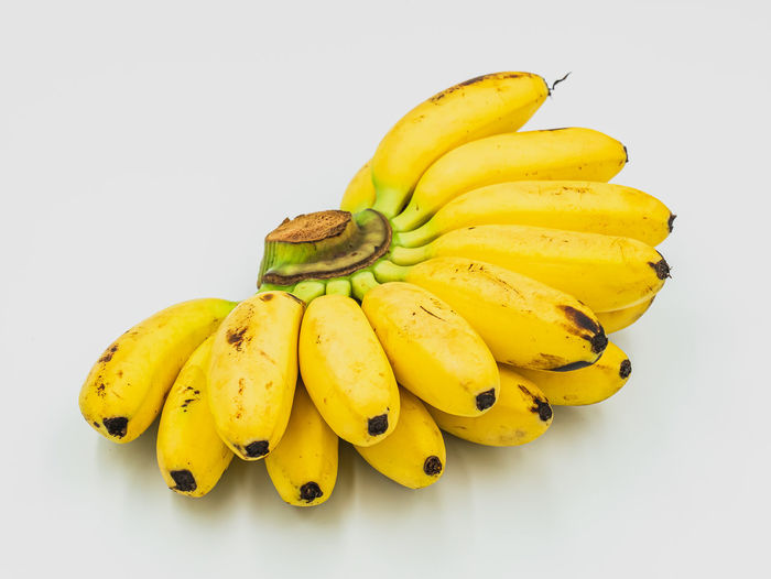 Close-up of yellow banana against white background