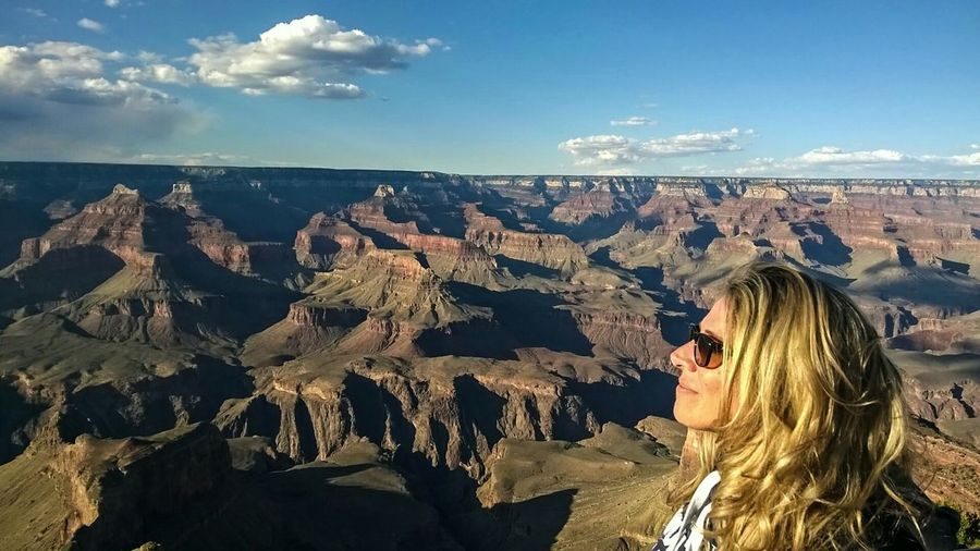 Side View Of Beautiful Woman At Grand Canyon National Park Against Sky