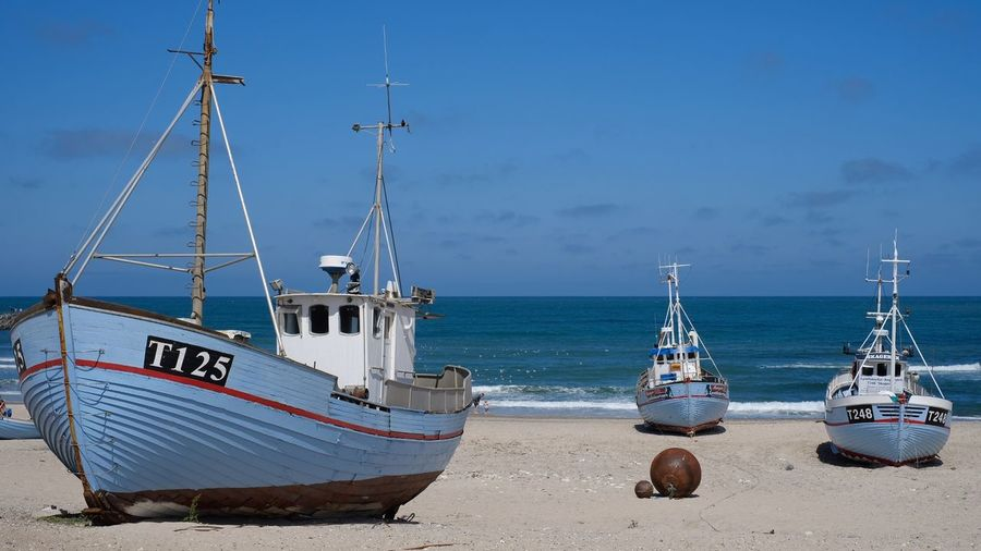 Fishing boats 🚣‍♀️ Nautical Vessel Water Mode Of Transportation Transportation Sea Sky Moored Blue Beach Day No People Travel Ship Outdoors Nature Land Fishing Boat Sailboat Beauty In Nature Fishing Industry