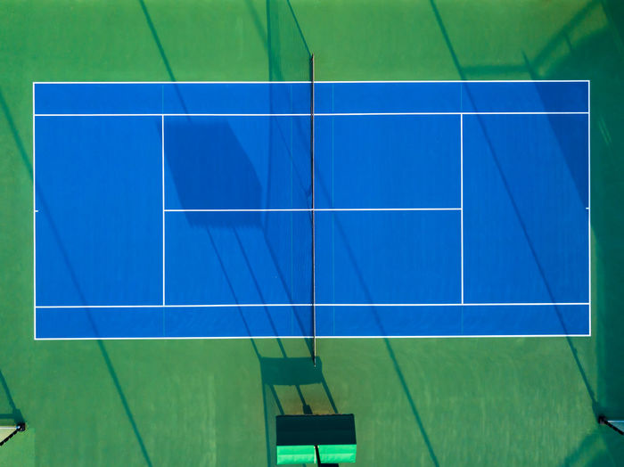 A tennis court from bird's perspective. Aerial Shot Blue Color Drone  Tennis The Week on EyeEm Aerial Photography Aerial View Backgrounds Competition Competitive Sport Day Droneshot Geometric Shape Green Color Nature No People Outdoors Pattern Sport Sunlight Tennis Court Tennis Court View From Above
