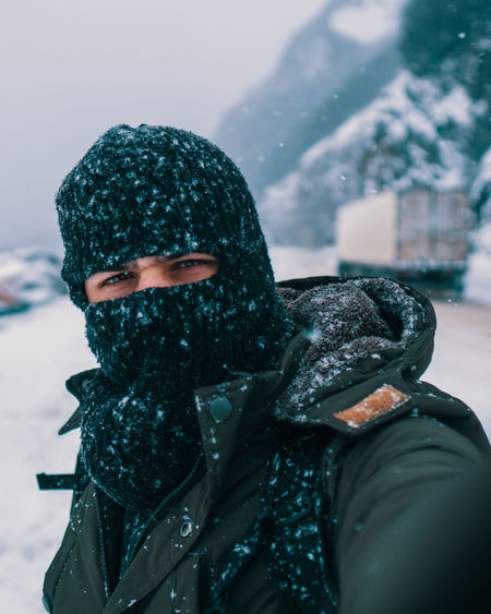 Portrait of person wearing hat during winter