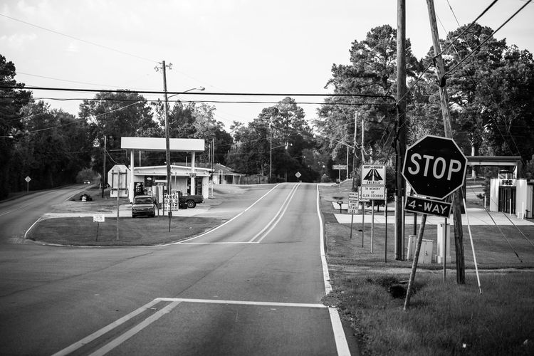 Blackandwhite Photography City Communication Day Empty Places Nikon D750 No People Outdoors Photographyisthemuse Quiet Places Road Road Sign Sky Small Town USA Stop Sign Street Text The Way Forward Transportation Tree