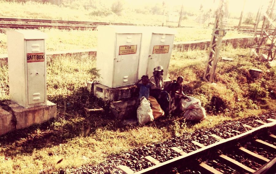 Poverty Ragpicker Family View From Train Window Painful Life Need For Help Reality Togetherness Rail Lines Garbage Economic Problems Eyemphotos Backward Railway Track Railway