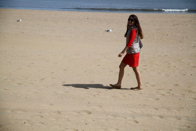 Americana Beach Photography Beach Walk USA Beach Beachphotography Beautiful Woman Full Length Nature One Person One Young Woman Only Outdoors Sand Sea Summer Vacations Walking On The Beach Young Adult Young Women