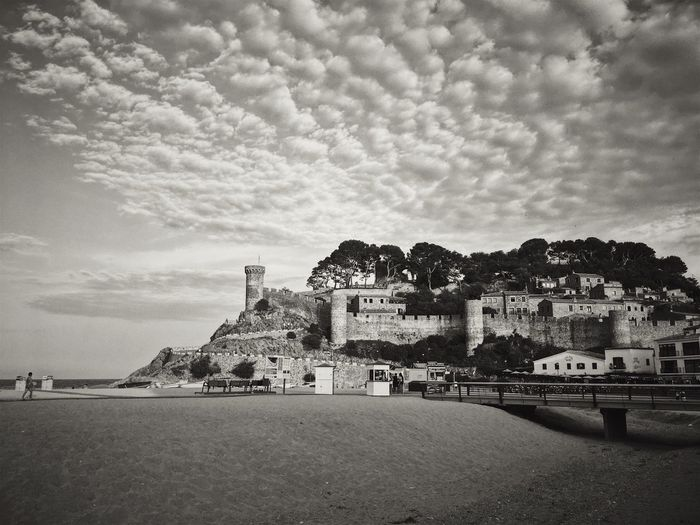 Town by sea against sky