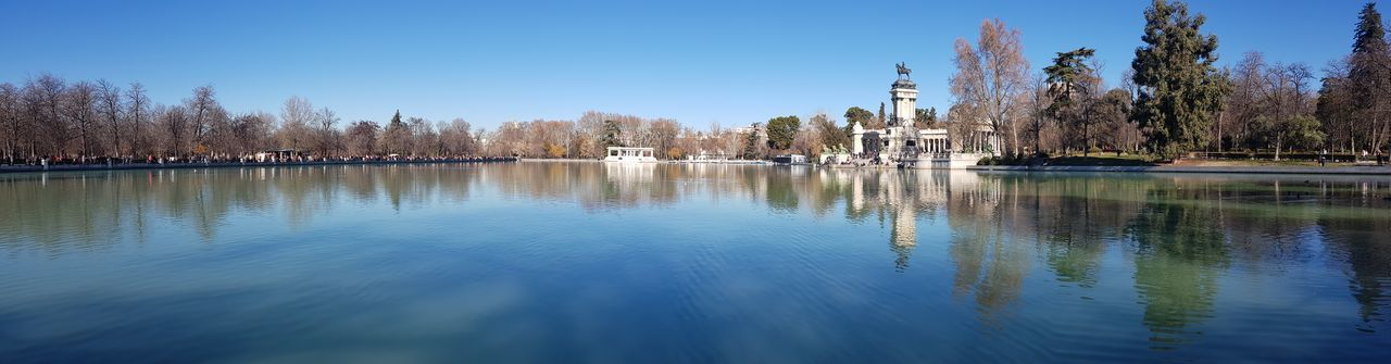 City EyeEm Best Shots Enjoying Life EyeEm Nature Lover EyeEmBestPics EyeEm Masterclass First Eyeem Photo Tourism Tranquility Tranquil Scene Taking Photos Travel Exceptional Photographs Thankful✨ Park Parque Del Retiro, Madrid, Spain Tree Water Clear Sky Lake Blue Reflection Sky Panoramic Calm