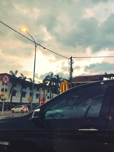When the sky goes grey, Golden Arches to save the day. Gold Yellow Mcdonalds Goldenarches Car Land Vehicle Transportation Mode Of Transport Cloud - Sky Sky Street Outdoors No People Sunset First Eyeem Photo