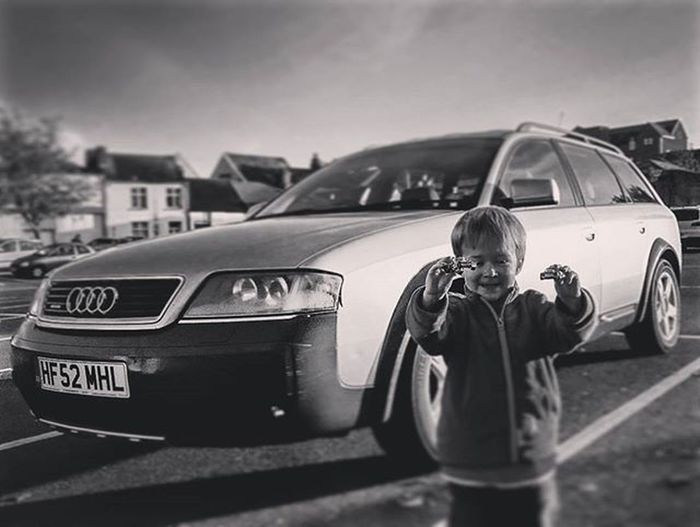 One little boy with 2 little cars and 1 big car Audiallroad Audi Allroad Quattro Billy