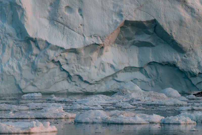Close-up of icebergs against mountain