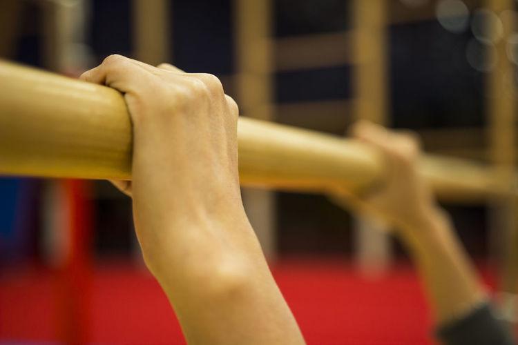 Cropped hand holding gymnastics equipment