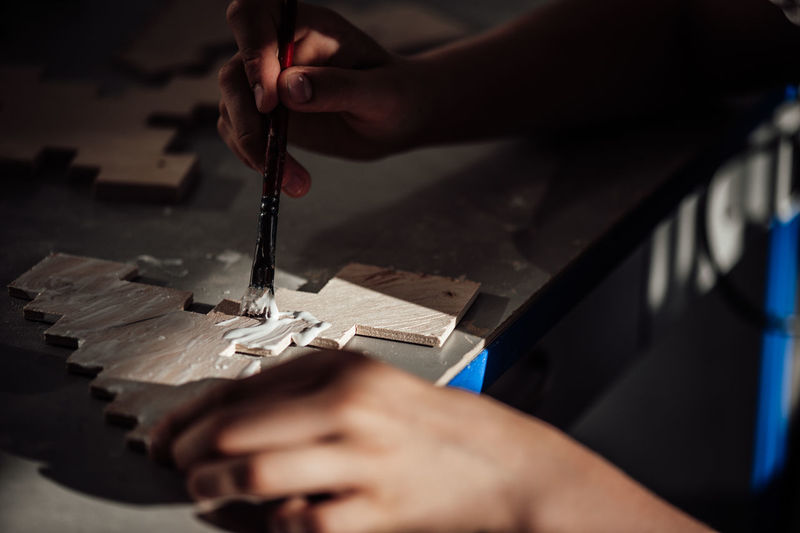 Cropped hand of person working in workshop