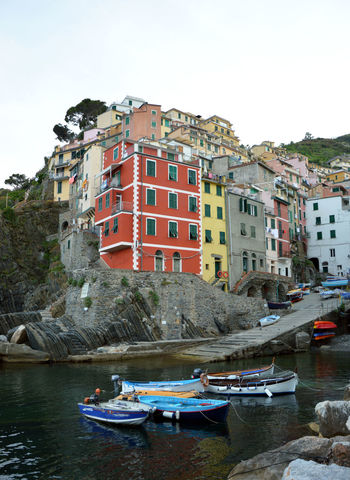 Cinque Terre Italian Landscape Italy Holidays Liguria - Riviera Di Ponente Riomaggiore, Riomaggiore, Italy, Architecture, Sea, Town, Beach, Brick, View, Harbor, Clothes, Sun, Window, Blue, Square, Mediterranean, House, Terrace, Europe, Italian, Colorful, Vacation, Wave, Cloud, Shutters,village, Coast, Wall, Tourism, Beautiful, Holiday, Trave Riomaggiori In Cinque Terra, Italy Boats Boats And Moorings Cinque Terre Cityscape Cinque Terre Italy Cinque Terre Liguria Colorful Houses Italy Riomaggiore Riomaggiore Cinque Terre