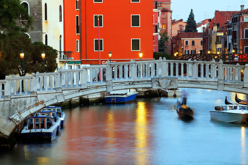 Footbridge over grand canal in city