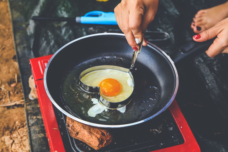 Camping Breakfast ,Fried Heart Egg and sausage Breakfast People Food Fried Hand Finger Egg Food And Drink Stove Preparing Food Preparation  Freshness Pan Fried Egg Healthy Eating Holding Frying Pan Human Hand Human Body Part Egg Yolk Kitchen Utensil Preparation  Camping Heart Shape Morning