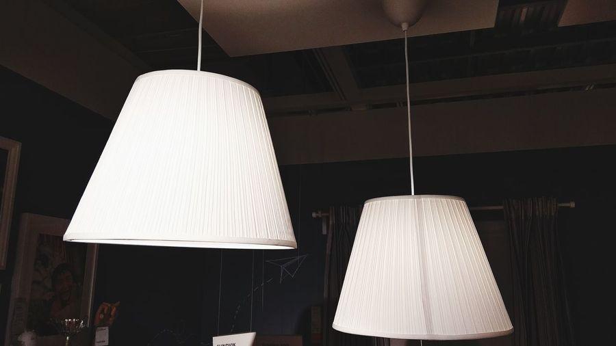 Close-up of illuminated pendant light at home