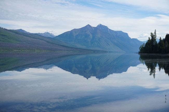 Mirror Beauty In Nature Cloud - Sky Day Glacier National Park Idyllic Lake Mirrorlake Mountain Mountain Range Nature No People Outdoors Purity Reflection Reflection Lake Scenics - Nature Sky Standing Water Symmetry Tranquil Scene Tranquility Waterfront